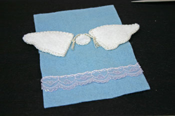 Easy Angel Crafts Angel Gift Bag finish sewing lace to bottom