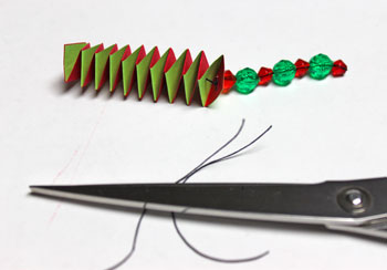 Catstep Braid and Bead Ornament step 14 tie knot to secure beads