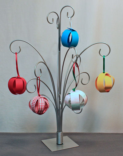 Easy Christmas Ornaments paper sphere several finished hanging on an ornament tree