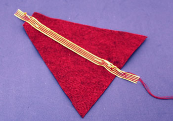 Easy Angel Crafts Felt Triangle Angel step 2 pin and sew ribbon to center front