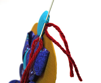 Easy Angel Crafts Yo Yo Angel Ornament step 22 add next yarn hair