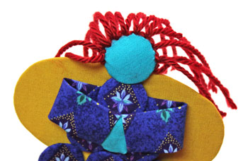 Easy Angel Crafts Yo Yo Angel Ornament step 23 finish yarn hair