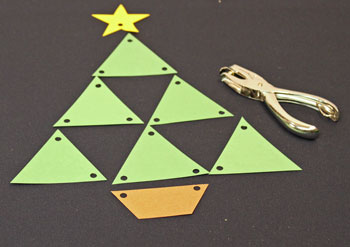 Easy Christmas Crafts Construction Paper Triangles Christmas Tree step 4 punch holes