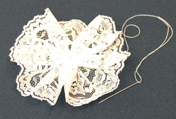Easy Christmas Crafts Lace Flower Ornament step 4 pull thread to gather