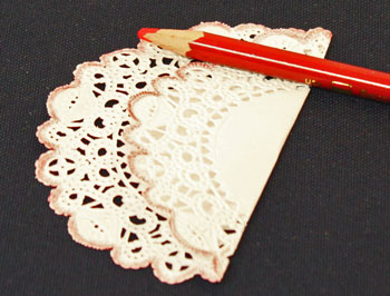 Easy Christmas Crafts Paper Doily Folded Christmas Tree Ornament step 2 fold the doily by two-thirds