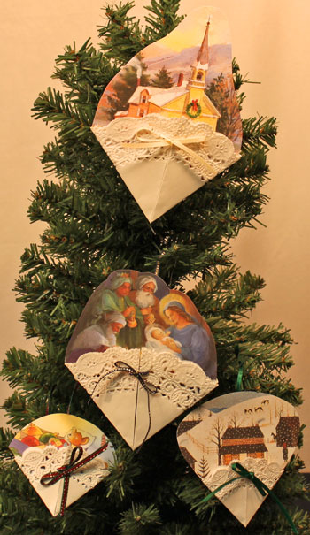 Easy Christmas Crafts Paper Doily Greeting Card Ornament four finished hanging on tree