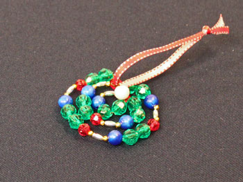 Easy Christmas Crafts Spiral Beaded Christmas Ornament Step 10 wrap beads in spiral
