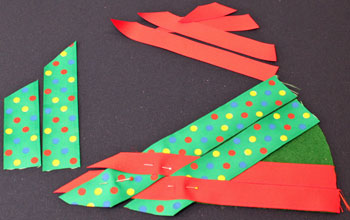 Easy Christmas Crafts Woven Ribbon Christmas Tree Door Hanger step 7 add next ribbon to weave