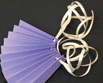 Easy Christmas Crafts Construction Paper Fan Ornament step 7 push ribbon through holes