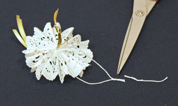 Easy Christmas Crafts Paper Doily Flower Ornament step 15 make yarn loop
