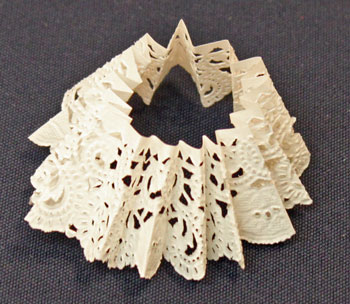 Easy Christmas Crafts Paper Doily Flower Ornament step 7 crease folds