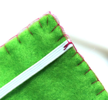 Easy Felt Crafts Notepad Cover2 step 16a sew multiple stitches at elastic