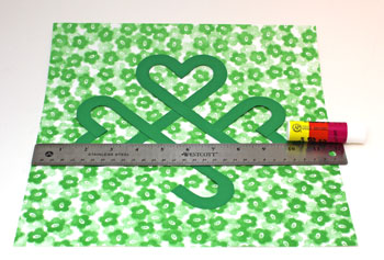 Glue the Irish Shamrock to the background paper.