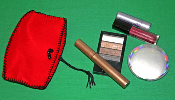 Easy felt crafts cosmetic pouch with cosmetics beside it