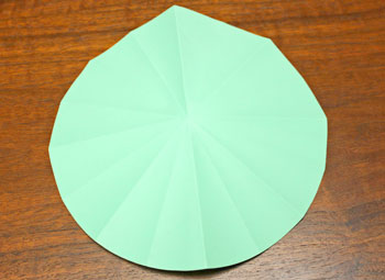 Folded Paper Circles Christmas Tree step 8 fold into sixteenths