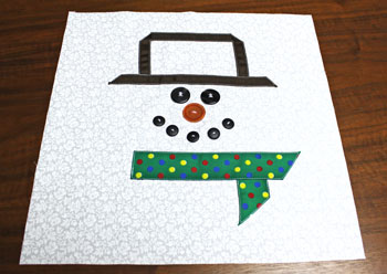 Fred the Snowman Pillow step 7 sew buttons