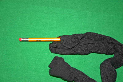 Frugal-Fun-Crafts-Mending-Socks-with-light-bulbs-trouser-sock-hole1