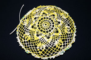 Frugal fun crafts doily pillow bow from yellow side