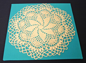 Frugal fun crafts framed doily position on background