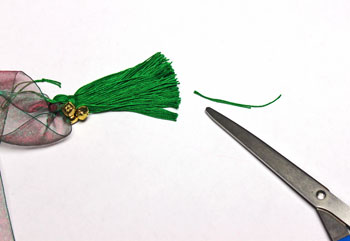 Ribbon and Bell Tassel Ornament step 17 trim yarn ends