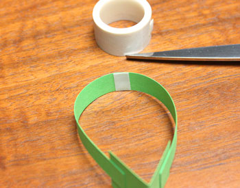 Singing Angel step 14 apply tape to center of arms
