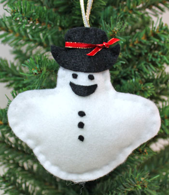 Stuffed felt snowman ornament finished on display
