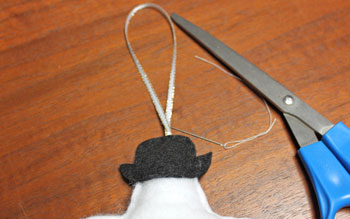 Stuffed felt snowman ornament step 10 sew ribbon loop