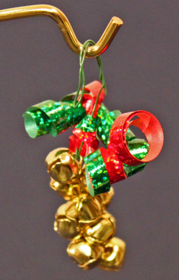 Easy Christmas Crafts Bell Ornament finished gold, red and green hanging on stand