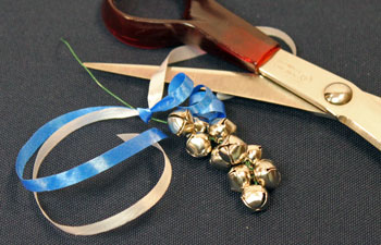 Easy Christmas Crafts Bell Ornament step 10 curl ribbon
