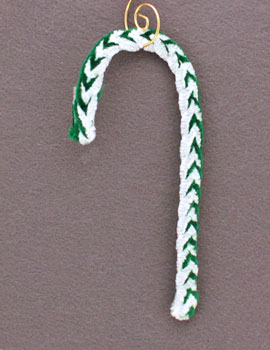 braided candy cane ornament hanging on display