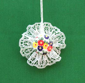 Button and Lace Ornament with flowered button on display