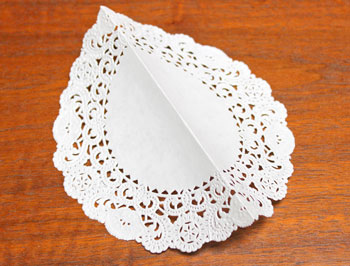 Cardstock and Doily Angel step 2 fold doily in half