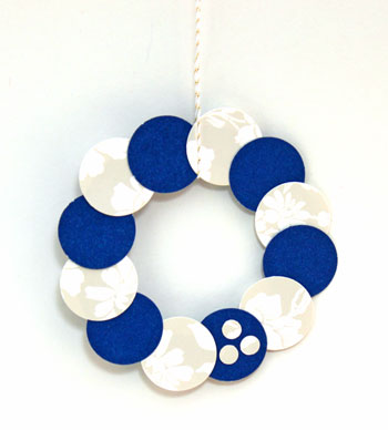 Circle Wreath Ornament blue and white on display