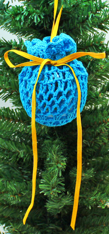 Crocheted Doily Wrapped Ornament blue finished on tree