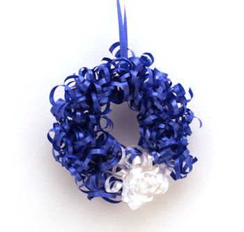 Curly Ribbon Ornament of blue and white ribbon on a white background
