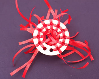 Curly Ribbon Ornament step 5 shows back of circle and ribbons