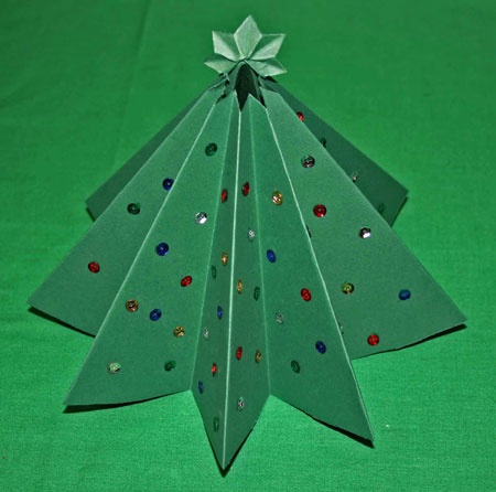 Easy Christmas crafts folded paper Christmas tree made with green card stock and sequins