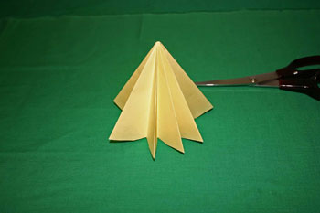 Easy Christmas crafts - folded paper Christmas tree tree stands on flat part of bottom