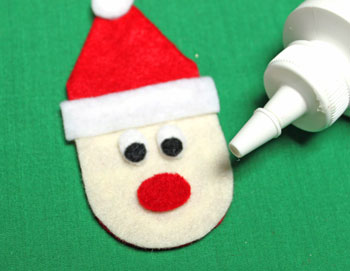 Easy Felt Santa Claus Ornament step 11 glue mouth to face