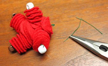 Felt and Bead Elf step 13 cut and crimp neck wires