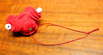 Felt and Bead Elf step 14 insert yarn and make loop