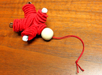 Felt and Bead Elf step 15 add bead for head