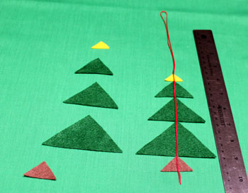 Felt Triangles Christmas Tree step 2 fold yarn over one set of triangles
