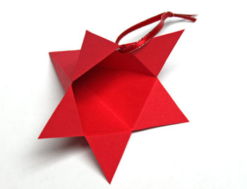 Five-point paper cone star step 10 make hanging loop