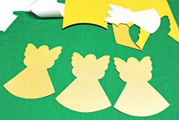 folded paper angel step 2 cut angel shapes