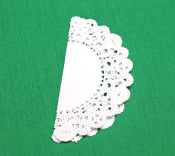 Folded Paper Doily Ornament step 1 make first fold in half