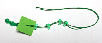 Geometric Icicle Ornament step 9 add four tri corner beads