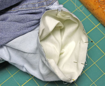 How to repair jeans pocket step 3 pin fabric to inside of the pocket