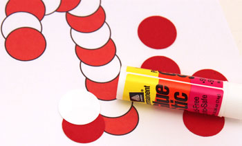 Paper Circles Candy Cane ornament step 2 begin gluing circles together