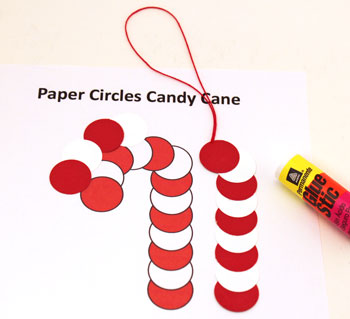 Paper Circles Candy Cane ornament step 3 add yarn loop between top circles